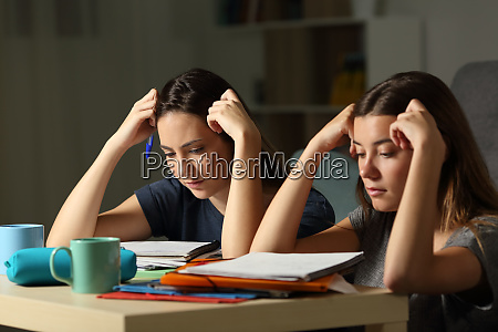 studious students memorizing late hours in