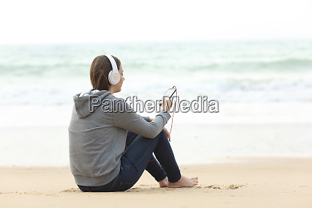 longing teen alone listening to music