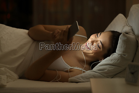 happy girl listening to music on