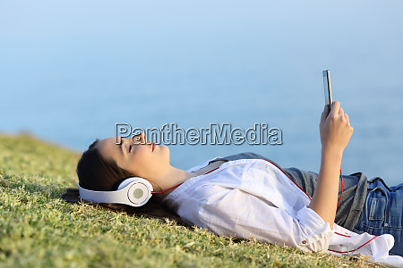 woman relaxing listening to music on