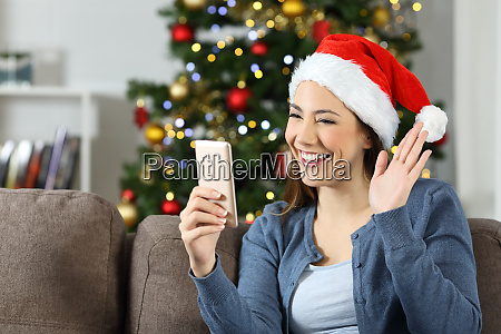 woman waving in a video call