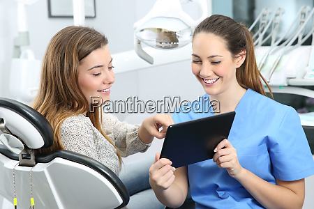 dentist and patient choosing treatment
