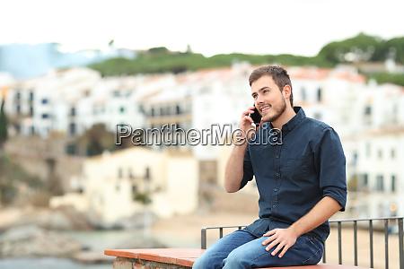 happy man talking on phone on