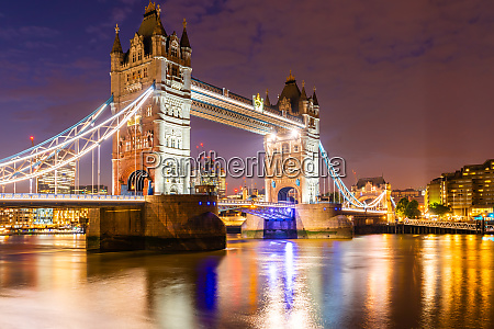 london tower bridge with downtown building