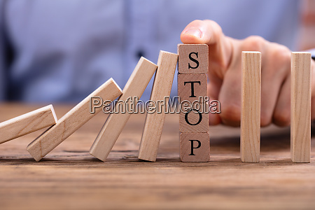 wooden blocks with stop text stopping