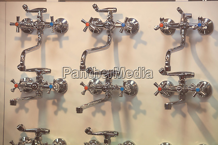 faucets on a wall