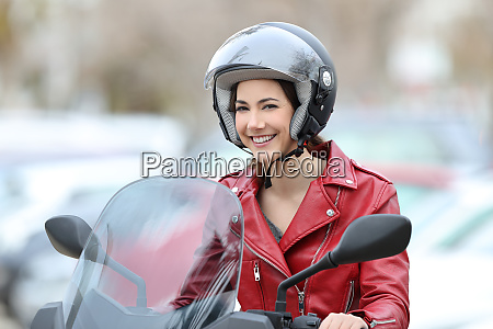 happy biker on a motorbike looking