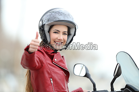 satisfied motorbiker gesturing thumbs up