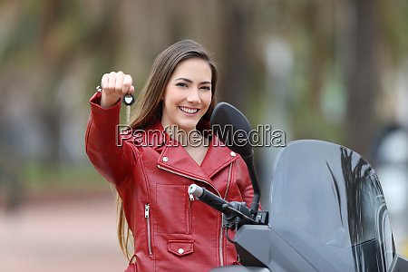 motorcycle buyer showing keys at camera
