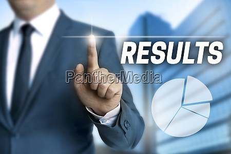 results touchscreen is operated by businessman