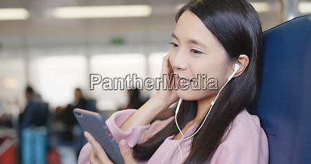 woman listen to music on ferry