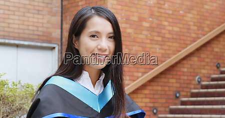 beautiful woman with graduation gown