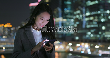 business woman read on smart phone