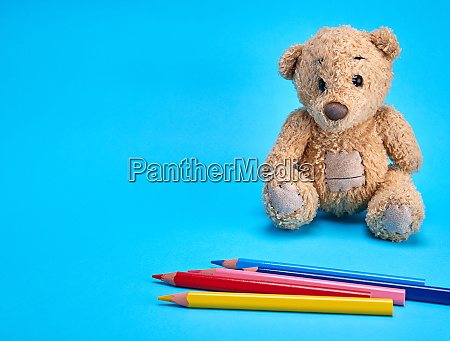 brown teddy bear and multicolored wooden