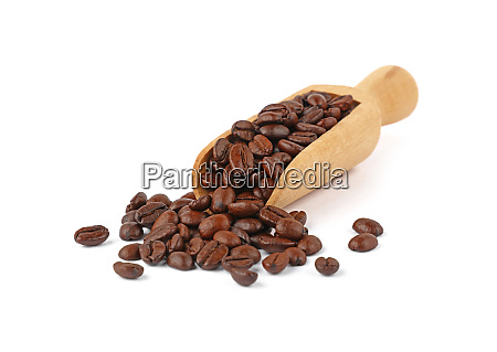 wooden scoop of roasted coffee beans