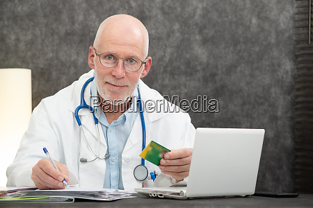 senior bearded doctor with health insurance
