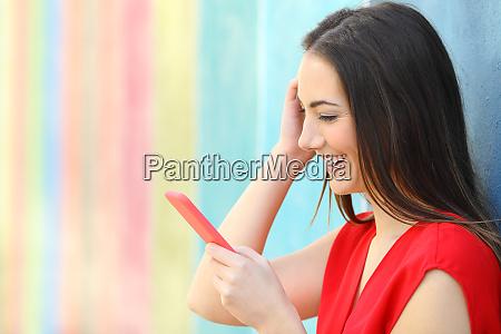 fashion happy woman checking smart phone