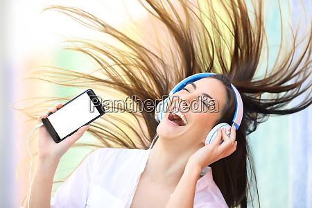 happy girl dancing listening to music