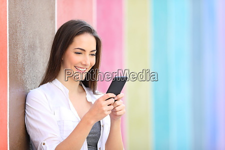 happy woman texting on smart phone