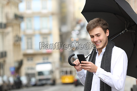 man using a smart phone in