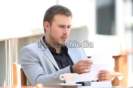 sad executive reading bad news in