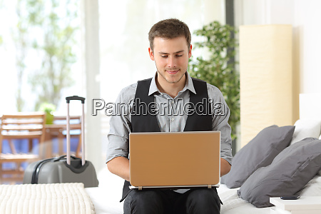 businessman working in an hotel during