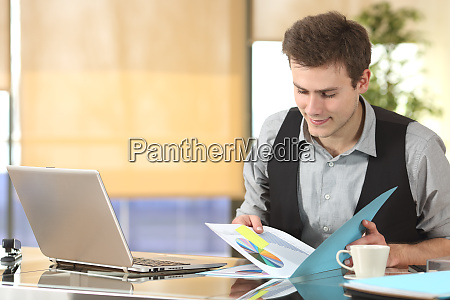 businessman working watching statistics