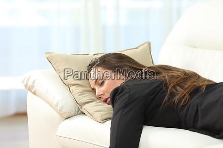 tired executive sleeping at home after