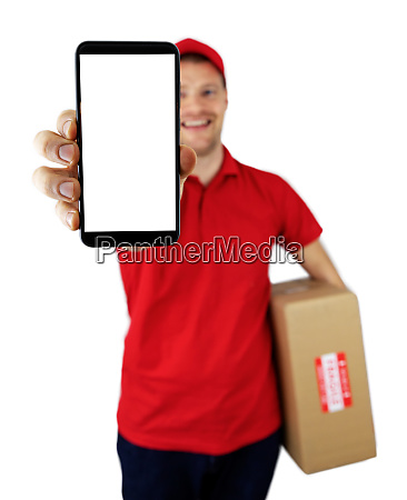 smiling delivery man showing smartphone with