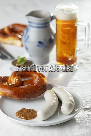 bavarian white sausages with pretzel