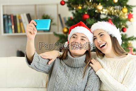 friends taking a selfie on christmas