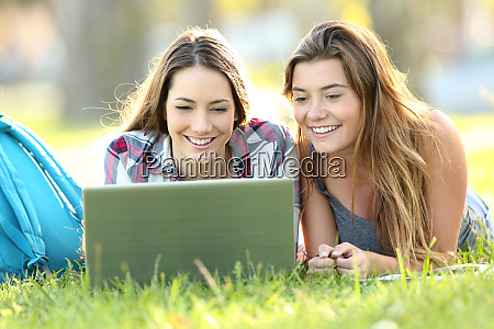 two students watching on line content