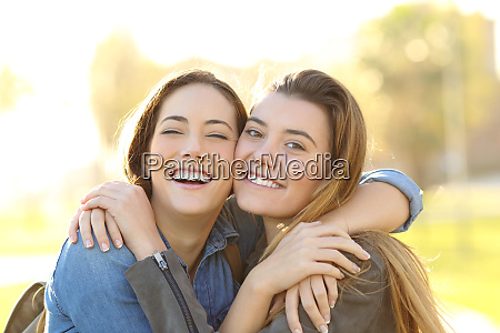 happy friends with perfect smile cuddling