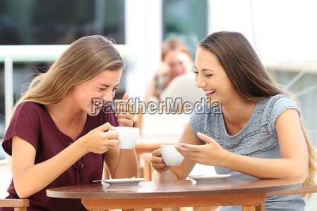 best friends laughing loud during a