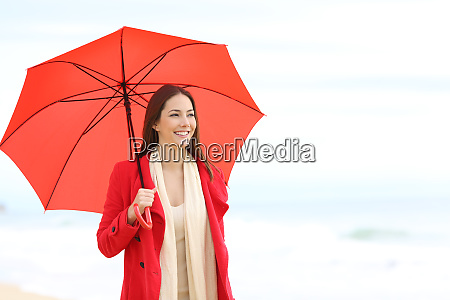happy woman in red holding an