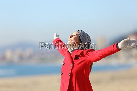 happy woman breathing raising arms in