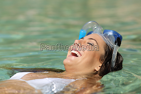 happy woman bathing in a turquoise