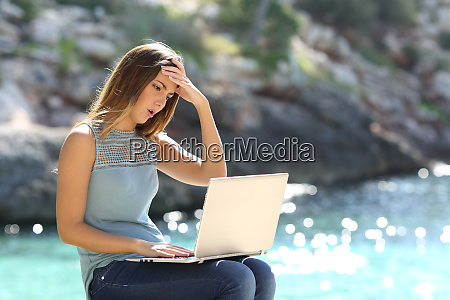 worried woman checking online information on