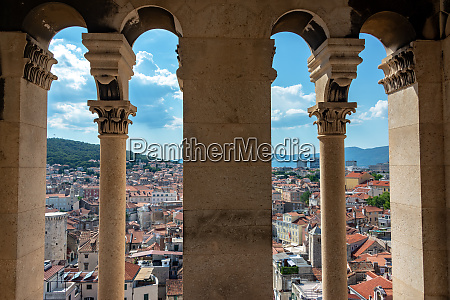 split cityscape from cathedral tower