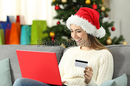 happy woman paying gifts online in