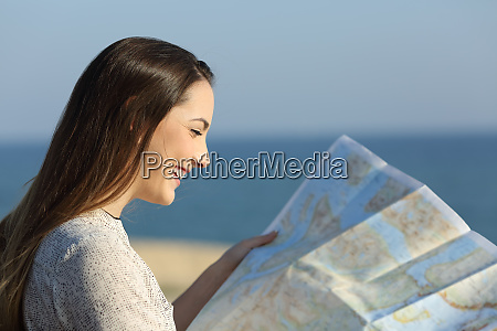 tourist reading a map on the
