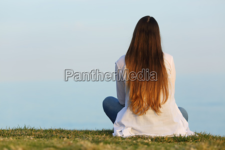 woman alone watching the sky sitting