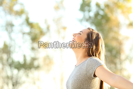 woman breathing fresh air outdoors in