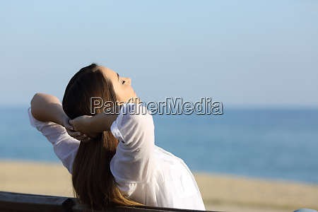 woman relaxing on a bench on