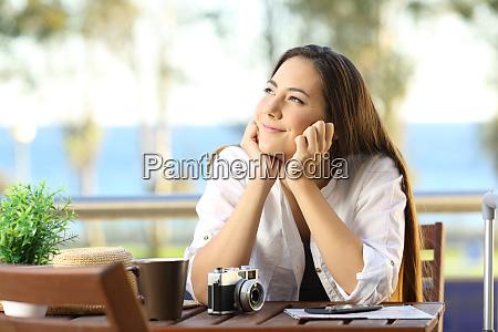 woman dreaming during a beach travel