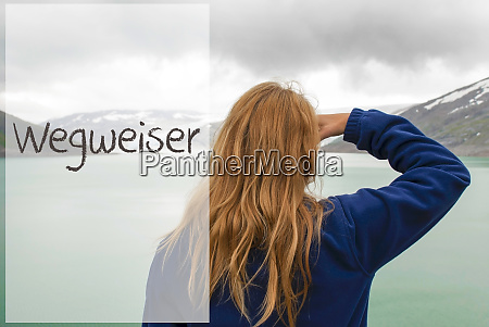 woman in norway german text wegweiser