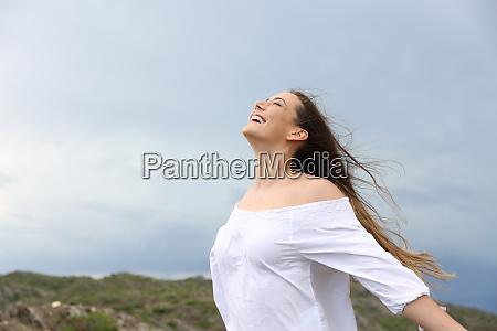 positive woman breathing enjoying the wind