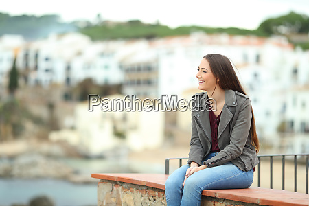 relaxed woman contemlating views in a