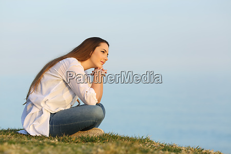 relaxed woman thinking and looking away