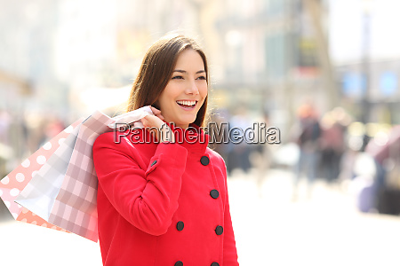 shopper in winter walking and holding